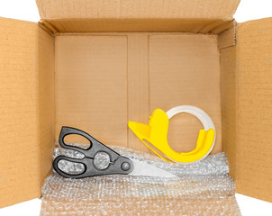 Packing tools in corrugated box, mailing shipping concept