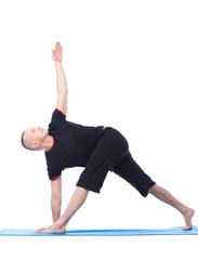 Yoga. Flexible man practising in studio