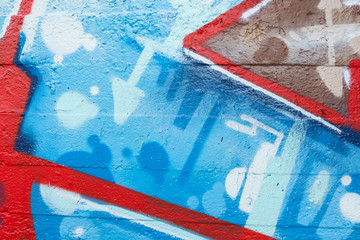 Graffiti closeup with arrows and blue dots