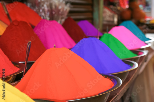 Piles of many colors of tikka powder for sell in india bazaar.