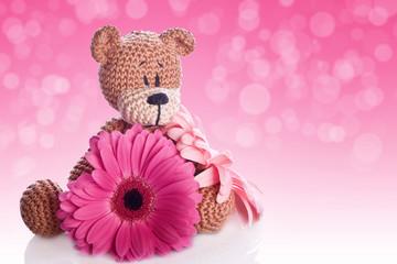 a brown teddy bear with magaritt