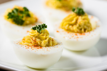 Deviled eggs garnished with parsley and paprika