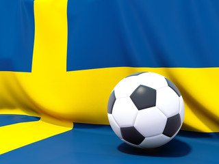 Flag of sweden with football in front of it