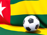 Flag of togo with football in front of it