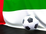 Flag of united arab emirates with football in front of it