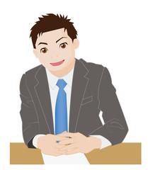 机の上でゆびを交差するビジネスマン