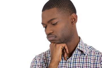 Closeup portrait of young depressed, sad man, white background
