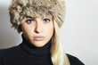 Beauty Fashion Blond Model Girl in Fur Hat.Winter Woman