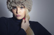 Beautiful Fashion Blond Woman in Fur Hat. Winter Girl