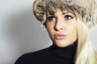 Beautiful Blond Young Woman in Fur Hat. Beauty Fashion Girl