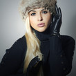 Fashion Girl in Fur Hat. Beautiful Blond Woman in Leather Glove
