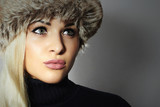 Beautiful Blond Young Woman in Fur Hat. Beauty Girl. Winter