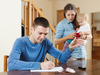 Family with baby having quarrel quarrel over money