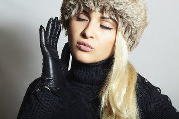 Beauty Fashion blond Girl in Fur Hat. Leather Gloves