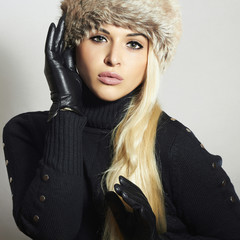 Beautiful Blond Woman in Leather Gloves.Beauty Girl in Fur Hat