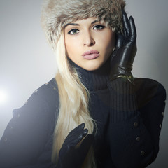 Beautiful Fashion Blond Woman in Fur Hat.Black Leather Gloves