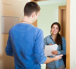Smiling woman surveys man
