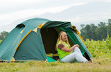 tourist in front camp tent