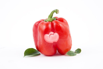 Two hearts on the fresh red paprika, a Valentines Day theme