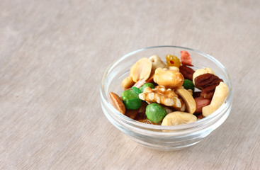 Assorted healthy mixed nuts on wooden textured background