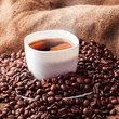 Square picture of white cup with coffee