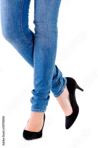 woman's legs and high heeled shoes