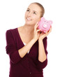 Young beautiful woman with piggy bank (money box),