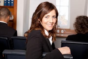 Geschäftfrau in einem Seminar