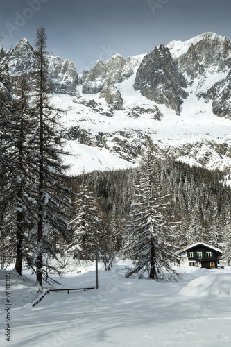 Val Ferret, mountain chalet in the snow among the trees