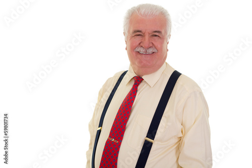 Happy senior man in braces and a red tie