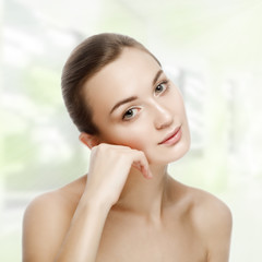 Beautiful girl sitting in tranquility. SPA concept. Skin Care. Y