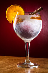 Gin tonic with cinnamon and orange
