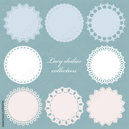 Set of cute lacy doilies on floral background.