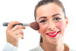 Attractive pretty smiling woman applying make up