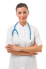 Young attractive woman doctor with stethoscope stands over white