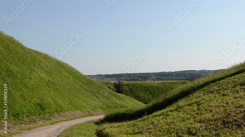People tourist climb on mound hills in historic capital Kernave