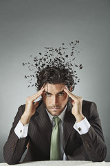 Businessman with scattered mind
