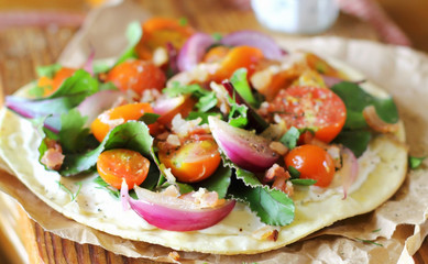 Flat bread with chard, tomatoes, red onion and crispy bacon
