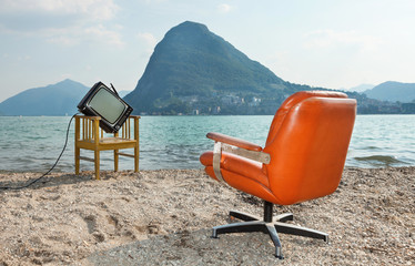 vintage decor on the lake shore,.armchair and television