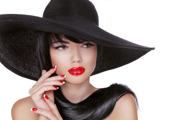 Glamour Fashion Brunette Woman Portrait in black hat isolated on