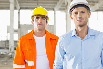 Portrait of confident male architects at construction site