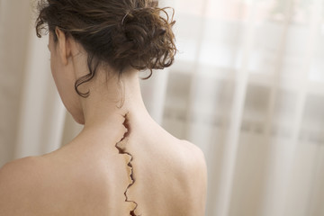 Back view of woman with crack on back