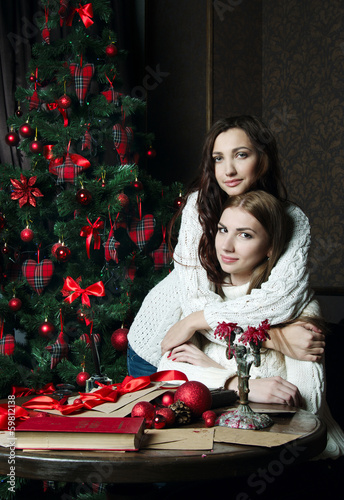 Beautiful girls in woolen sweaters, New Year