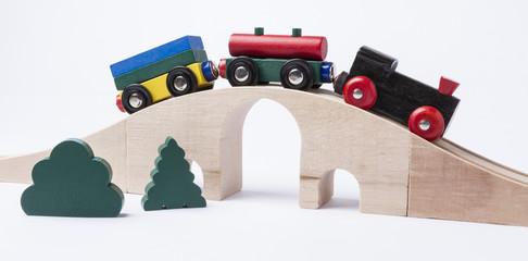 wooden toy train on bridge