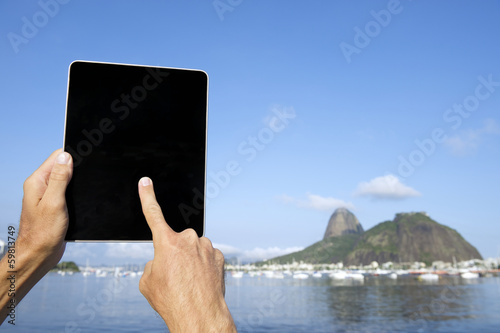 Traveling Tourist Using Tablet at Sugarloaf Rio Brazil