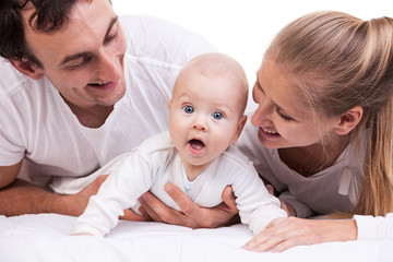 Closeup of young family with baby boy against white