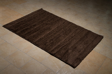 Single Brown Carpet Folded On Floor