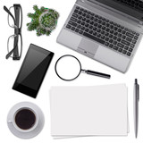 Modern office desk supplies isolated on white