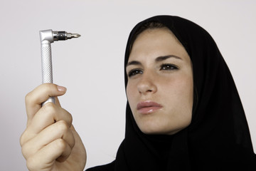 Arab Girl Wonder About Her Next Invention