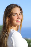 Fototapety Portrait of a beautiful woman with a white perfect smile